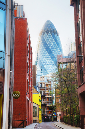 extensively: LONDON - APRIL 14: 30 St Mary Axe skyscraper on April 14, 2015 in London, UK. With 41 storeys, it is 180 metres tall and stands on the former site of the Baltic Exchange, which was extensively damaged in 1992. Editorial