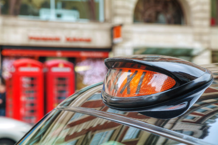 hackney carriage: Famous taxi cab (hackney) on a street in London, UK Stock Photo