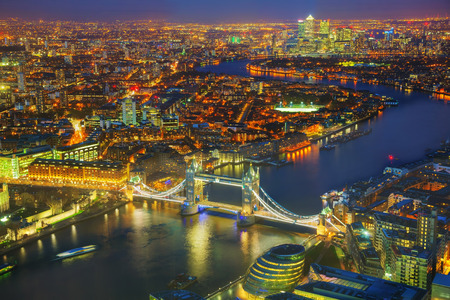 great britain: Aerial overview of London city with the Tower bridge at the night time Stock Photo