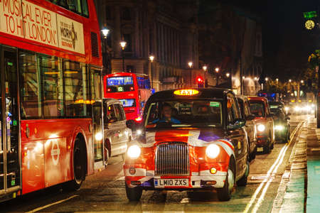 hackney carriage: LONDON - APRIL 14: Famous taxi cab (hackney) on a street on April 14, 2015 in London, UK. A hackney or hackney carriage (also called a cab, black cab, hack or London taxi) is a carriage or automobile for hire.