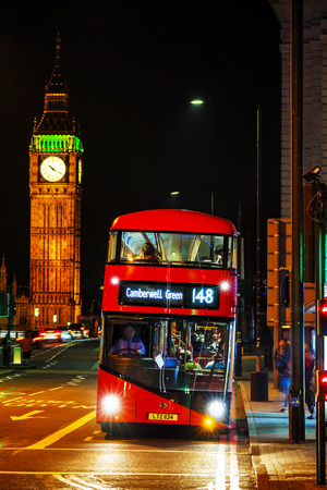 archetypal: LONDON - APRIL 14: Iconic red double decker bus on April 14, 2015 in London, UK. The London Bus is one of Londons principal icons, the archetypal red rear-entrance Routemaster recognised worldwide. Editorial