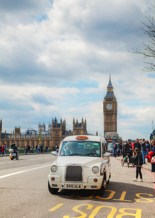 hackney carriage: LONDON - APRIL 5: Famous taxi cab (hackney) on a street on April 5, 2015 in London, UK. A hackney or hackney carriage (a cab, black cab, hack or London taxi) is a carriage or automobile for hire.