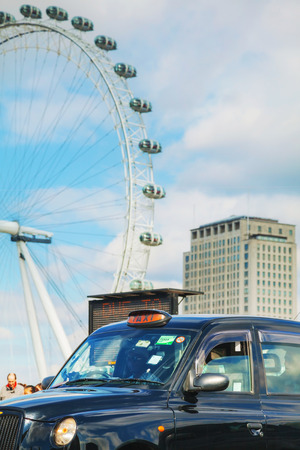 hackney carriage: LONDON - APRIL 5: Famous taxi cab (hackney) an a street on April 5, 2015 in London, UK. A hackney or hackney carriage (a cab, black cab, hack or London taxi) is a carriage or automobile for hire.