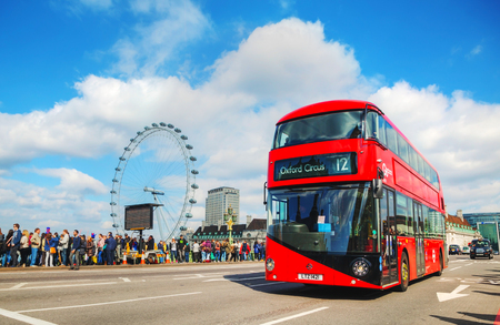 recognised: LONDON - APRIL 5: Iconic red double decker bus on April 5, 2015 in London, UK. The London Bus is one of Londons principal icons, the archetypal red rear-entrance Routemaster recognised worldwide. Editorial