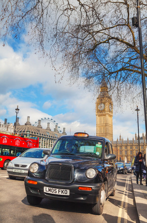 hackney carriage: LONDON - APRIL 12: Famous taxi cab (hackney) at the Parliament square on April 12, 2015 in London, UK. A hackney or hackney carriage (a cab, black cab, hack or London taxi) is a carriage or automobile for hire. Editorial