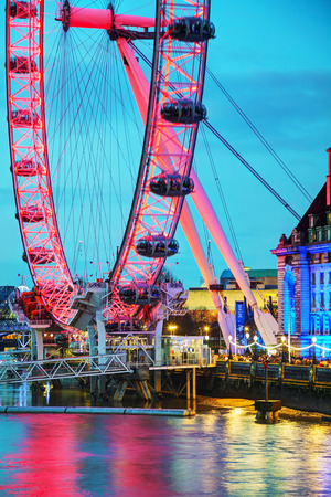 metres: LONDON - APRIL 5: The London Eye Ferris wheel in the evening on April 5, 2015 in London, UK. The entire structure is 135 metres tall and the wheel has a diameter of 120 metres. Editorial