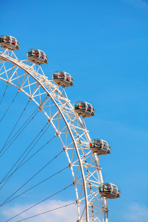 metres: LONDON - APRIL 12: The London Eye Ferris wheel close-up on April 12, 2015 in London, UK. The entire structure is 135 metres tall and the wheel has a diameter of 120 metres.