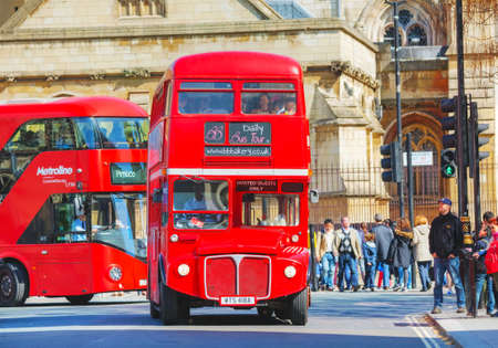 archetypal: LONDON - APRIL 12: Iconic red double decker bus on April 12, 2015 in London, UK. The London Bus is one of Londons principal icons, the archetypal red rear-entrance Routemaster recognised worldwide.