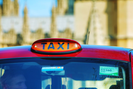 hackney carriage: LONDON - APRIL 12: Famous taxi cab (hackney) on a street on April 12, 2015 in London, UK. A hackney or hackney carriage (a cab, black cab, hack or London taxi) is a carriage or automobile for hire. Editorial