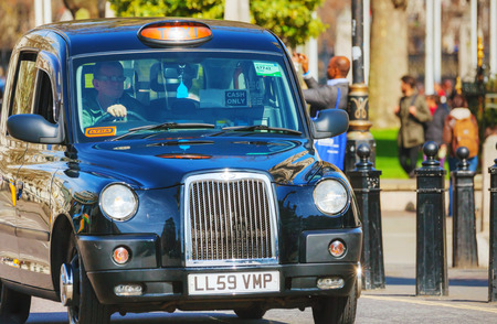 hack: LONDON - APRIL 12: Famous taxi cab (hackney) an a street on April 12, 2015 in London, UK. A hackney or hackney carriage (also called a cab, black cab, hack or London taxi) is a carriage or automobile for hire.