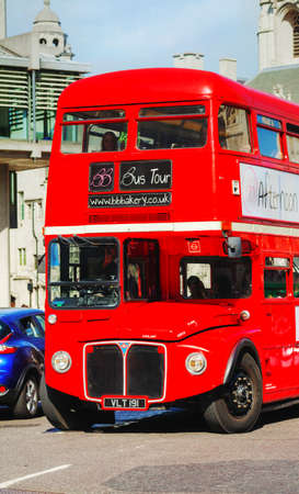 recognised: LONDON - APRIL 12: Iconic red double decker bus on April 12, 2015 in London, UK. The London Bus is one of Londons principal icons, the archetypal red rear-entrance Routemaster recognised worldwide.