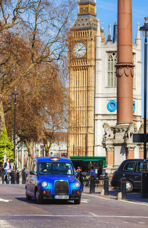 hackney carriage: LONDON - APRIL 12: Famous taxi cab (hackney) an a street on April 12, 2015 in London, UK. A hackney or hackney carriage (also called a cab, black cab, hack or London taxi) is a carriage or automobile for hire.