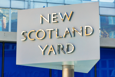 territorial: LONDON - APRIL 12: Famous New Scotland Yard sign on April 12, 2015 in London, UK. Its a metonym for the headquarters of the Metropolitan Police Service, the territorial police force of London.