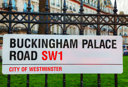 english famous: LONDON - APRIL12: Buckingham Palace Road sign on April 12, 2015 in London, UK. Its the London residence and principal workplace of the monarchy of the United Kingdom.