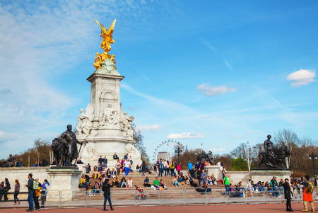 LONDON - APRIL 12: Queen Victoria memorial monument in front of the Buckingham palace on April 12, 2015 in London, UK. Its a monument to Queen Victoria, located at the end of The Mall in London.