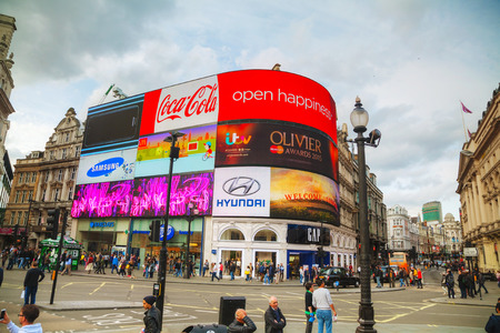 crowded space: LONDON - APRIL 12: Piccadilly Circus junction crowded by people on April 12, 2015 in London, UK. Its a road junction and public space of Londons West End in the City of Westminster, built in 1819.