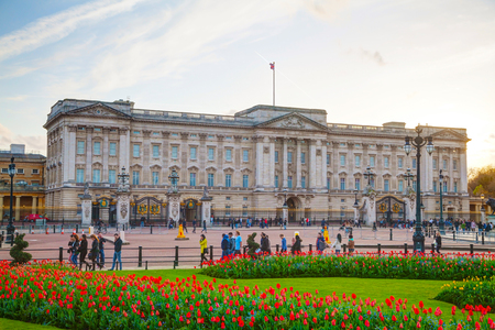 LONDON - APRIL 12: Buckingham palace at sunset on April 12, 2015 in London, UK. Its the London residence and principal workplace of the monarchy of the United Kingdom.