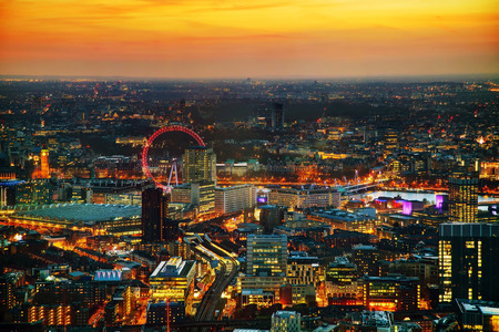 Aerial overview of London city at the sunset time