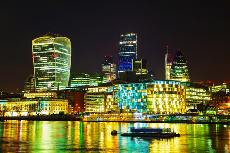 famous building: Financial district of the City of London in the night