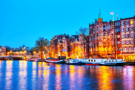 amstel: Night city view of Amsterdam, the Netherlands with the Amstel river