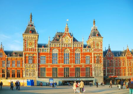 AMSTERDAM - APRIL 15: Amsterdam Centraal railway station on April 15, 2015 in Amsterdam, Netherlands. Amsterdam Centraal is the largest railway station of Amsterdam, and a major national railway hub. Editorial
