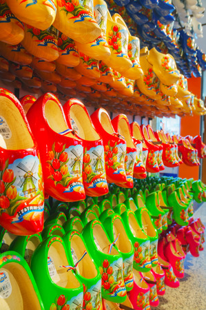 AMSTERDAM - APRIL 16: Colourful traditional Dutch wooden shoes (klomps) on April 16, 2015 in Amsterdam. Approximately 3 million pairs of klompen are made each year and sold throughout the Netherlands.