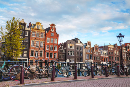 dutch canal house: Bicycles parked on a bridge in Amsterdam, the Netherlands Stock Photo