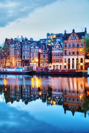 amstel river: Night city view of Amsterdam, the Netherlands with the Amstel river