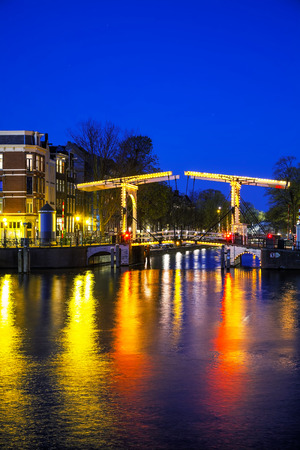 amstel: Night city view of Amsterdam, the Netherlands with Amstel river