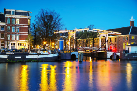 amstel river: Night city view of Amsterdam, the Netherlands with Amstel river