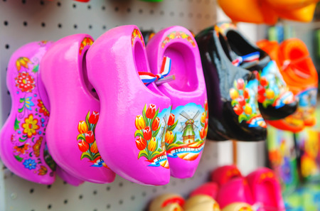 AMSTERDAM - APRIL 17: Colourful traditional Dutch wooden shoes (klomps) on April 17, 2015 in Amsterdam. Approximately 3 million pairs of klompen are made each year and sold throughout the Netherlands.