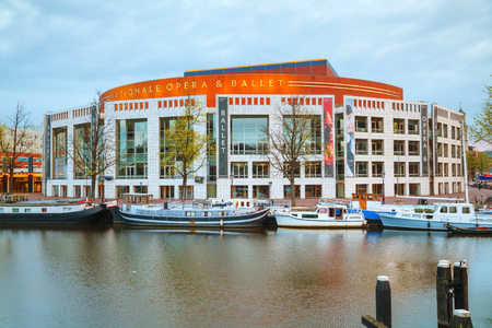 nationale: AMSTERDAM - APRIL 16: Nationale opera and ballet building (Stopera) on April 16, 2015 in Amsterdam, Netherlands. The Stopera is located in the center of Amsterdam.