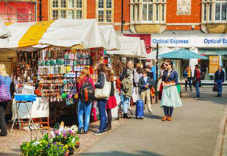 cambridge: CAMBRIDGE, UK - APRIL 9: Street souvenir shops at the Market square on April 9, 2015 in Cambridge, UK. Cambridge is most widely known as the home of the University of Cambridge, founded in 1209.