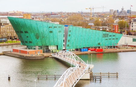nemo: AMSTERDAM - APRIL 16: Science Center Nemo building on April 16, 2015 in Amsterdam, Netherlands. It contains five floors of hands-on science exhibitions and is the largest science center in the Netherlands. Editorial