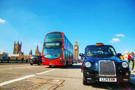 hackney carriage: LONDON - APRIL 6: Famous taxi cab (hackney) on a street on April 6, 2015 in London, UK. A hackney or hackney carriage (a cab, black cab, hack or London taxi) is a carriage or automobile for hire.