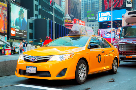 yellow cab: NEW YORK CITY - SEPTEMBER 04: Yellow cab at Times square in the morning on October 4, 2015 in New York City. Its major commercial intersection and neighborhood in Midtown Manhattan at the junction of Broadway and 7th Avenue.