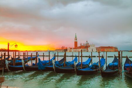 grand canal: Gondolas floating in the Grand Canal at sunrise Stock Photo