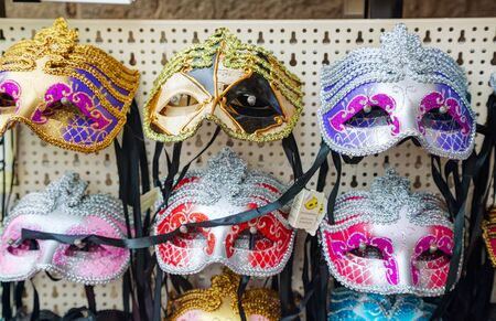 masquerade masks: VENICE - NOVEMBER 20: Masquerade Venetian masks  on sale on November 20, 2015 in Venice, Italy. The annual Carnival of Venice is world-famed for its elaborate masks. Editorial