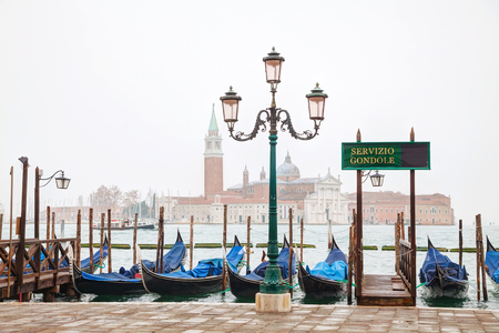 grand canal: Gondolas floating in the Grand Canal on a cloudy day