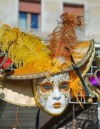 masquerade masks: VENICE - NOVEMBER 22: Masquerade Venetian masks on sale on November 22, 2015 in Venice, Italy. The annual Carnival of Venice is world-famed for its elaborate masks.