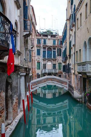 venice: Narrow canal with bridge in Venice, Italy Stock Photo