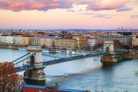 szechenyi: Overview of Budapest with the Szechenyi Chain Bridge in Budapest at sunset