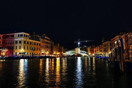 Rialto bridge (Ponte di Rialto) in Venice, Italy at night