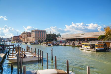 corridors: VENICE - NOVEMBER 22: Overview of Grand Canal and train station on November 22, 2015 in Venice, Italy. It forms one of the major water-traffic corridors in the city.