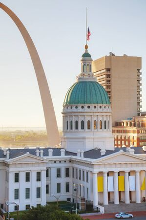 st louis: Downtown St Louis, MO with the Gateway Arch at sunrise
