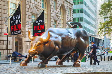 charging bull: NEW YORK CITY - September 5: Charging Bull sculpture on September 5, 2015 in New York City. The sculpture is both a popular tourist destination, as well as one of the most iconic images of New York.