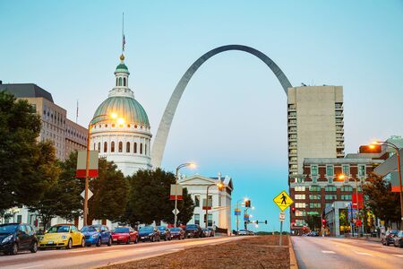 st louis: Downtown St Louis, MO with the Old Courthouse and the Gateway Arch at sunset
