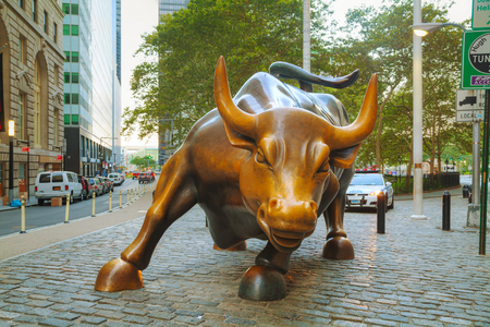 NEW YORK CITY - September 5: Charging Bull sculpture on September 5, 2015 in New York City. The sculpture is both a popular tourist destination, as well as one of the most iconic images of New York.