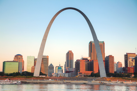 of st: Downtown St Louis, MO with the Old Courthouse and the Gateway Arch at sunrise
