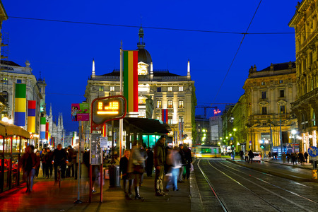 MILAN, ITALY - NOVEMBER 24: Via Dante shopping street with people at night on November 24, 2015 in Milan, Italy.